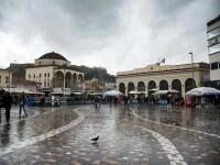 Cum s-a simtit Atena de ziua ei. Grecii, in cautarea unui euro pierdut. FOTO REPORTAJ