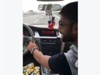 Un sofer inconstient s-a filmat in timp ce conducea masina de pe locul din dreapta volanului. VIDEO