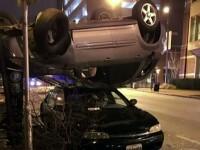 Cum a ajuns o masina cu susul in jos pe capota unui alt automobil. Politistii au gasit explicatia