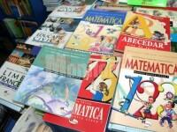 """Guvernul promite că va """"găsi soluţii astfel încât să existe acces la manuale pentru copii"""""""