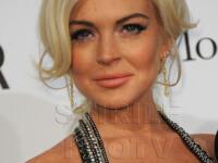 Lindsay Lohan pozeaza pentru Playboy. FOTO