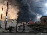 Batalia pentru Mosul lasa in urma sute de morti si raniti. ISIS a folosit un buldozer pentru a se descotorosi de cadavre