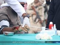 Imagini șocante. Militanți ai Statului Islamic taie mâna unui bărbat