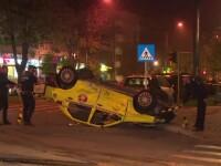 Accident în Vaslui: un taxi s-a răsturnat cu roţile în sus