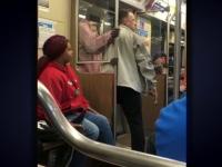 Momentul în care un călător din metrou a imobilizat un bărbat înarmat cu un pistol