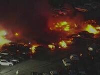 Zeci de mașini care urmau să fie scoase la licitație au ars într-o parcare din SUA. Pagubele sunt uriașe