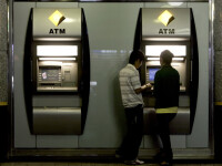 Falsificatori de bancomate cu