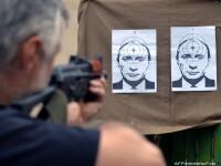 Fotografii cu Vladimir Putin sunt folosite ca tinta intr-un poligon din vestul Ucrainei. FOTO