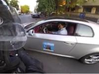 Scena revoltatoare, surprinsa in traficul din Bucuresti. Reactia unui sofer care a taiat calea unui motociclist. VIDEO