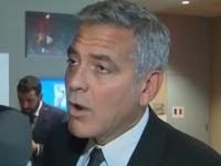 Momentul in care George Clooney a aflat in direct la CNN ca prietenul de-o viata, Brad Pitt, divorteaza. VIDEO