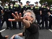 Arestări la Sydney şi Melbourne, după manifestaţii împotriva restricţiilor. Cinci polițiști au fost călcați în picioare