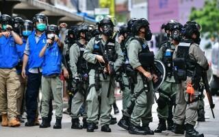 Proteste în Hong Kong din cauza legii securităţii naţionale. Poliţia a intervenit cu gaze lacrimogene. GALERIE FOTO - 10