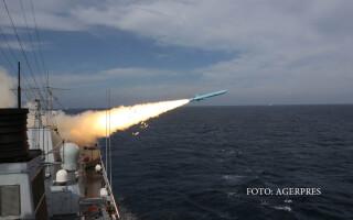nava chineza care trage o racheta