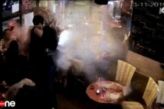 Momentul socant in care unul dintre teroristii din Paris isi detoneaza centura intr-o cafenea. Imaginile surprinse de camere