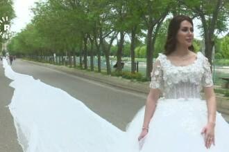 O femeie designer de origine kurda din Irak a creat rochia de mireasa cu cea mai lunga trena, 200 de metri. Cum arata