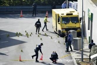 Zeci de barbati au jefuit sediul unei firme de securitate, iar un politist a fost ucis. Suma fabuloasa pe care au furat-o