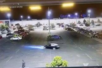 Șoferul oprit cu focuri de armă, pentru că a făcut drifturi în parcarea unui mall, cercetat în libertate