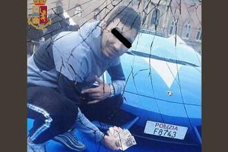 Român arestat în Italia după ce și-a făcut un selfie cu mașina Poliției. Un câine l-a dat de gol