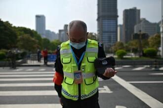 FOTO&VIDEO. Întreaga Chină a păstrat 3 minute de reculegere în memoria victimelor COVID-19