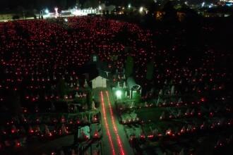 18.000 de candele, aprinse în cimitirele din Râmnicu Vâlcea în noaptea de Înviere