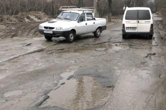 Made in Romania: astupam gropi, pe ploaie si ninsoare