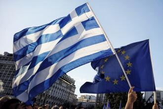Grecia continua negocierile cu creditorii internationali pentru a primi prima transa de 20 mld de euro