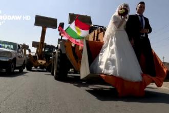 Un mire din Kurdistan a venit cu excavatoarele la nunta, dupa mireasa. Reactia tinerei cand a vazut utilajele
