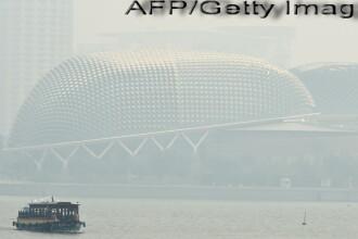 Situatie ingrijoratoare in Singapore, din cauza poluarii. Orasul este acoperit de un nor de fum inecacios