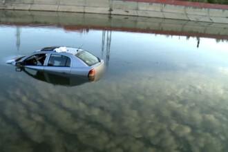 Accident spectaculos in Capitala. O femeie a plonjat cu masina in Dambovita, a iesit singura din vehicul si a plecat acasa