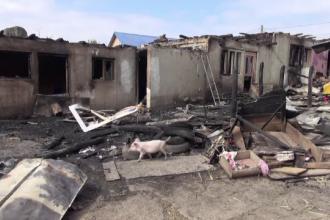 """Reacția a 3 copii orfani, atunci când și-au văzut casa în flăcări. """"A fost șoc"""""""