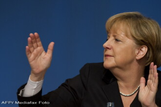 Angela Merkel apara moneda euro, pe care o considera mai puternica decat marca, fosta moneda germana
