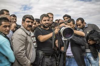 TIME a ales fotograful anului 2014. 3 imagini cutremuratoare pe care le-a surprins in cele mai periculoase locuri din lume