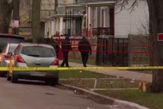 Un tanar de culoare din Chicago a fost ucis de politie dupa o cearta de familie. O vecina a fost si ea impuscata de agenti