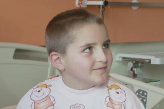 Un baiat de 8 ani a primit un cadou deosebit de Sarbatori. Cativa medici din Cluj l-au operat gratuit de strabism