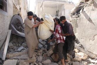 Rusia anunta ca a descoperit gropi cu cadavre in orasul sirian Alep: