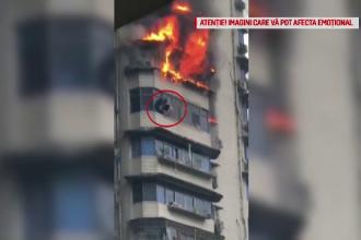 Salvat în ultima clipă după ce a stat agățat de balcon la 100 de metri înalțime