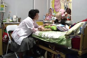 Copii care stau cu lunile într-o cameră mică de spital. Firmele încă pot dona 20% din impozitul pe profit