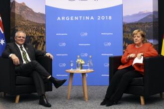"""Angela Merkel """"a trișat"""" la întâlnirea cu premierul Australiei. Gestul care a dat-o de gol"""