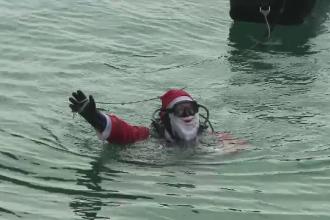 Moş Crăciun a ajuns înot până la Constanța Surprizele pregătite pentru cei mici