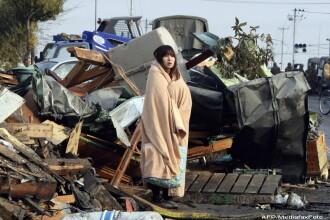 Fotografia emblema a tragediei din Japonia ascunde un miracol. Citeste povestea incredibila