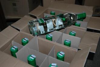 Politistii din Satu Mare au amendat un tanar care transporta sute de litri de tuica fara acte