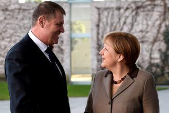 Klaus Iohannis, poză cu Angela Merkel. Ce au discutat cei doi oficiali la Bruxelles