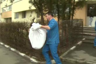 Cadavrul unui bebelus, gasit in ghena unui bloc din Capitala. Anchetatorii sunt acum pe urmele mamei