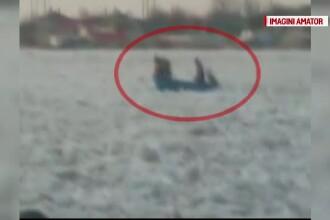 Situatie disperata pentru oamenii din Delta Dunarii. Trei barbati, filmati in timp ce incearca sa traverseze fluviul inghetat