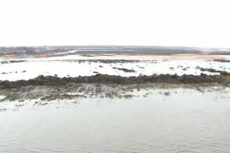 Mai multe localitati din Galati, inundate de zapada topita, dar si de precipitatiile din aceste zile