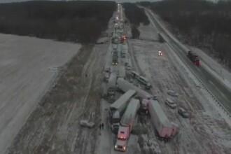Carambol cu 100 de mașini pe o autostradă din SUA, din cauza zăpezii. O persoană a murit