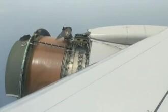 Momente de groază pentru pasageri: învelișul metalic al unui motor s-a desprins