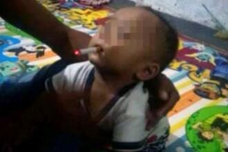 Un tată și-a forțat bebelușul de 9 luni să fumeze și a publicat fotografia. Reacția autorităților