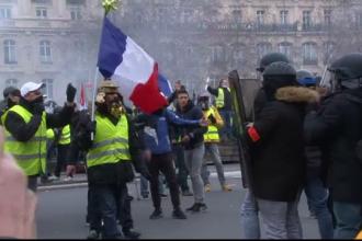 60.000 de veste galbene pe străzi în Franța. Omagiu adus răniților din confruntări