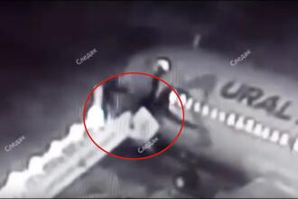 Momentul în care scara unui avion se rupe iar pasagerii cad în gol. Reacţia liniei aeriene